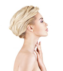 Blond Model Touching Her Fingers to Neck Copy
