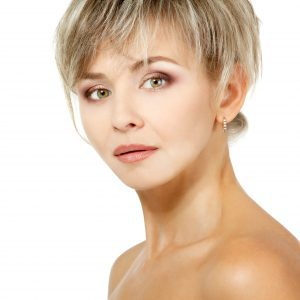Short Blond Haired Mature Model with Bare Shoulders