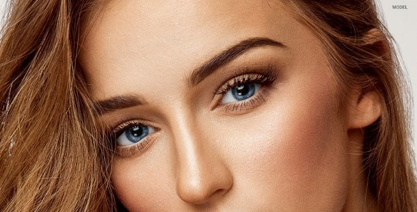 Bronzed Model with Blue Eyes Close Up