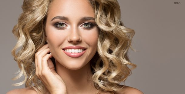 Elegant Model with Beautiful Face and Curly Blond Hair