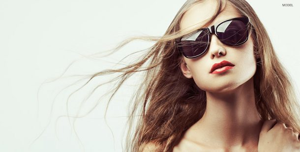 Female Model Wearing Dark Sunglasses