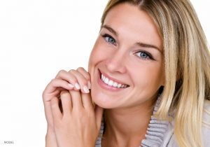Smiling Young Blonde Caucasian Women with Narrow Nose